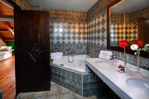 Foto del baño de Apartamentos Villa de Plan