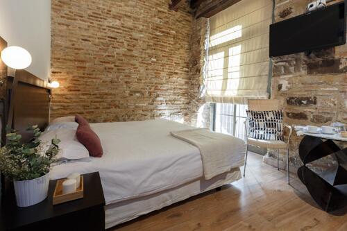 Foto di una camera da AinB Picasso-Corders Apartments
