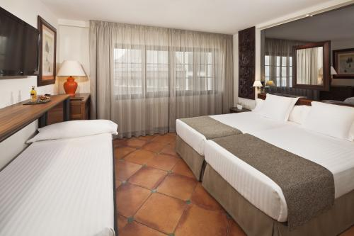 Quarto - Hotel Meliá Sol y Nieve